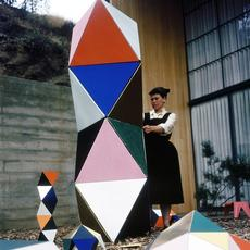 "Designer Ray Eames with an early prototype of ""The Toy"" in the patio of the Eames House, 1950, in Pacific Palisades, Calif."