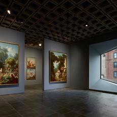 Room 24: Four grand panels of Fragonard's series The Progress of Love are shown together at Frick Madison in a gallery illuminated by one of Marcel Breuer's trapezoidal windows.  This view shows two of the 1771 –72 paintings, with two later overdoors visible in the next gallery; photo: Joe Coscia