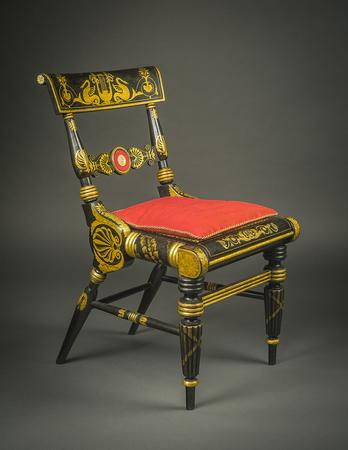 "FAPG 20618D/2.1 Attributed to John (1777–1851) and Hugh (1781–1831) Finlay, Baltimore (active about 1800/01–30) Painted Black and Gilded ""Fancy"" Side Chair, about 1830 Poplar, painted and gilded, with die-stamped gilt-brass rosettes, caning, and original red moreen fabric [beneath replacement fabric on rondel] 33 3/4 in.  high, 18 5/8 in.  wide, 23 3/4 in.  deep overall"