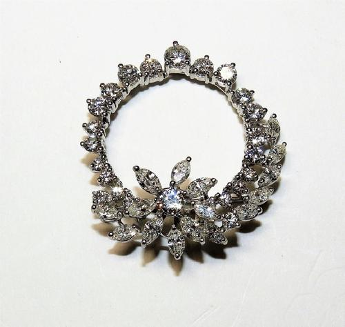 Gorgeous diamond and platinum lady's wreath brooch, boasting 16 marquise-cut and 24 round-cut diamonds arranged as a wreath and with embellished floral accents (est.  $6,000-$9,000).