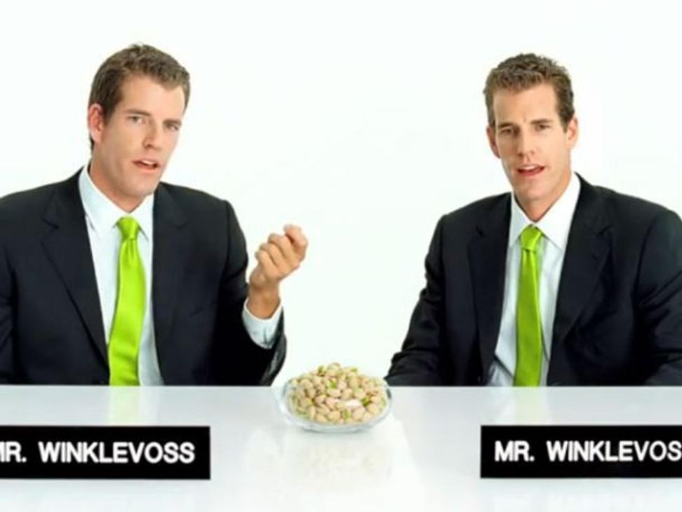 Paddle8 advisors Cameron and Tyler Winklevoss shown in a TV commerical for pistachios.  The pair famously sued Mark Zuckerberg over Facebook and are known as early advocates of Bitcoin.