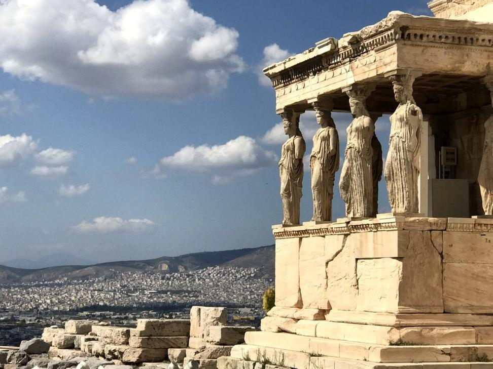 View towards the Erechtheion on the Acropolis in Athens.  Replicas replace the original maiden or 'Korai' pillars, the marble caryatids from 421BC-406BC, that are in the Acropolis Museum (located nearby the site); one resides at the British Museum in London.