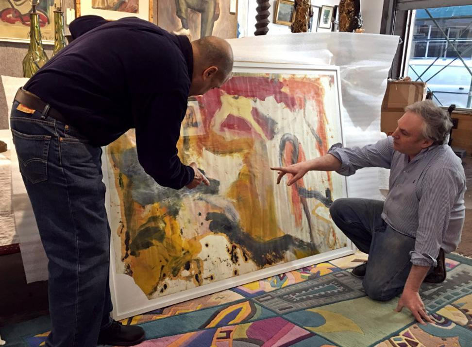 Art dealer David Killen, right, and Lawrence Castagna, an art-restoration expert who once worked for artist Willem de Kooning, look over a painting, in New York.