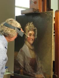 Independent conservator Gay Myers removing the varnish from Gilbert Stuart's Abigail Smith Adams (Mrs.  John Adams), (1800/1815).  National Gallery of Art, Washington, Gift of Mrs.  Robert Homans
