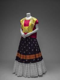 Cotton huipil with machine-embroidered chain stitch; printed cotton skirt with embroidery and holán (ruffle)