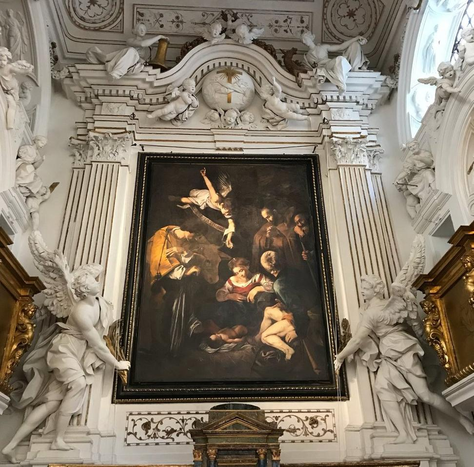 "A copy of ""Nativity with San Lorenzo and San Francesco"" by Caravaggio hangs where the original was stolen from a church in Sicily."