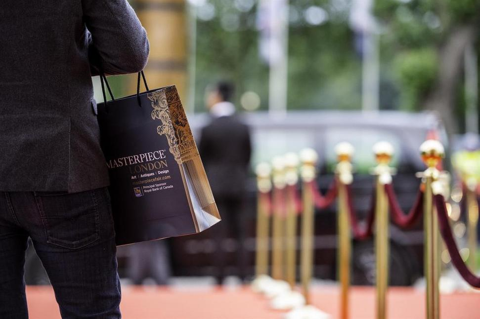 Arriving on the red carpet of Masterpiece London.  Photography by Andy Barnham