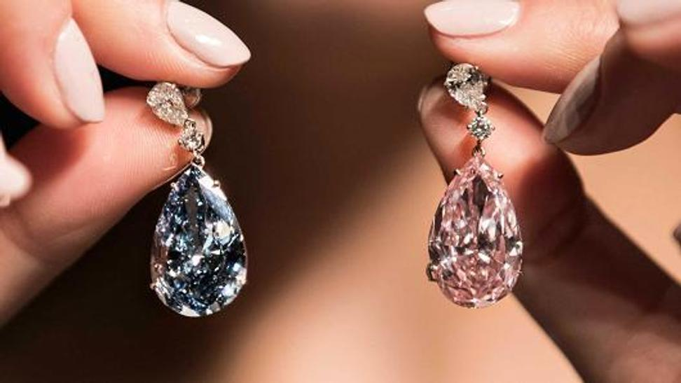 """The Apollo Blue"" earring went for $42.1 million, and ""The Artemis Pink"" diamond sold for $15.3 million."