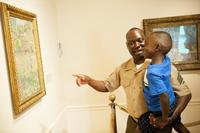Marine Sgt.  Jimmy Ochan and his son William enjoy their visit to the Phillips Collection in Washington, DC, at the 2015 launch event for Blue Star Museums.  Photo by James Kegley.