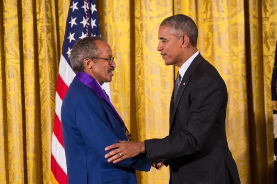 "Former President Barack Obama presents the National Medal of Arts to Jack Whitten in a White House ceremony on September 22, 2016.  A citation read during the ceremony said, ""As an abstract artist, he uses 'casting,' acrylic paints, and compounds to create new surfaces and textures, challenging our perceptions of shape and color.  His powerful works of art put the American story in a new light."" Photo by Cheriss May, Ndemay Media Group"