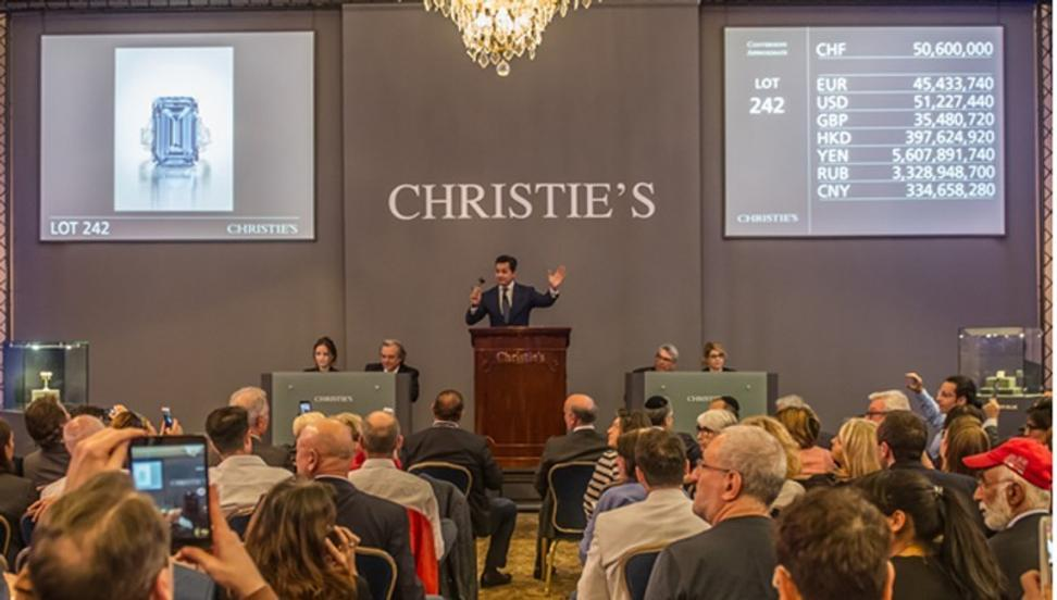 Christie's sells the Oppenheimer Blue diamond for a record $57.5 million.