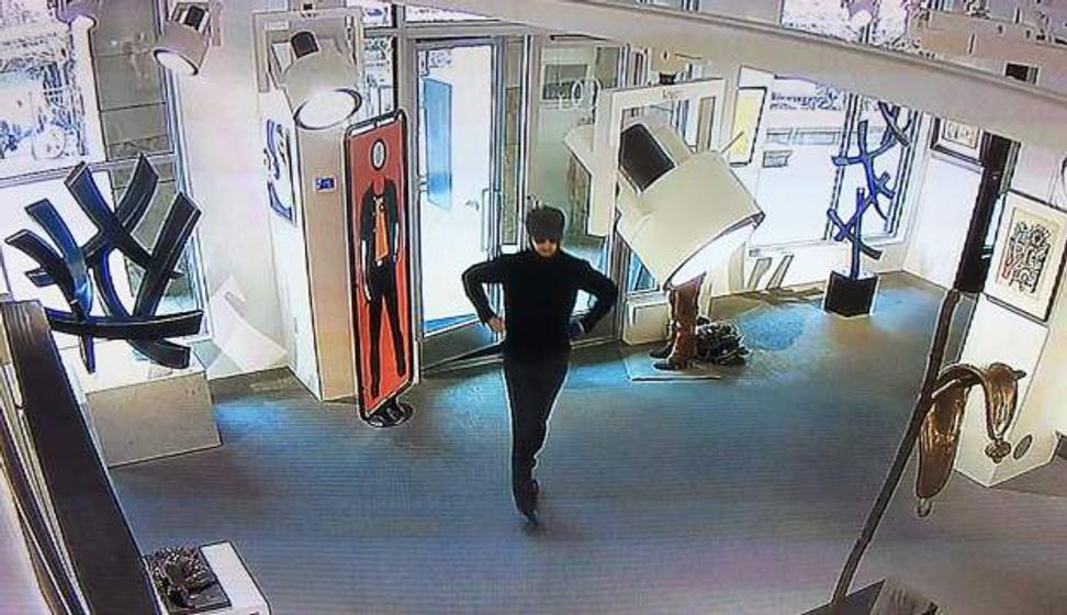 A screen shot from surveillance cameras inside an Aspen art gallery show the suspect right before he slashed a nearly $3 million painting in May 2017.