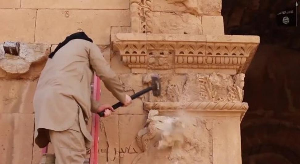 Still from supposed Islamic State video showing militants destroying artifacts in Iraq's Unesco World Heritage city of Hatra.
