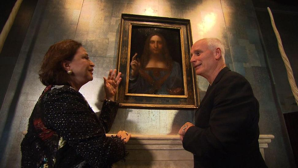 Restorer Dianne Modestini and CNN presenter Nick Glass with Da Vinci's 'Salvator Mundi'.