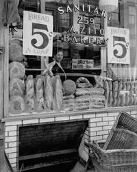 Berenice Abbott (1898–1991) Bread Store, 259 Bleeker Street, 1937.  Gelatin silver print.  Museum of the City of New York, 49.282.57