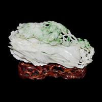 "Jade cabbage, Qing Dynasty.  7 1/4"".  Gianguan Auctions Lot 149.  $280,000-$380,000."