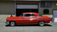 A Lipstick Red 1955 Chrysler New Yorker Newport