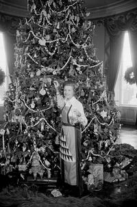 Betty Ford with the 1975 White House Christmas tree.  AARFAM was honored to provide the ornaments for the tree that year.