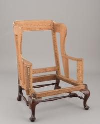 Easy chair, attributed to the Anthony Hay Shop, Williamsburg, Virginia, c.  1765, mahogany, ash, yellow pine and tulip poplar; iron and linen fragment; gift of Mr.  and Mrs.  Vernon M.  Geddy, Jr., 1989-372