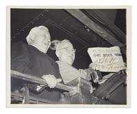 "Lot 216: Harry S.  Truman, Photograph Signed and Inscribed, ""Too bad!,"" showing the false newspaper headline announcing the winner of the 1948 presidential election.  Estimate $12,000 to $18,000."
