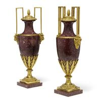 A pair of good quality Louis XVI style gilt bronze mounted porphyry covered urns, 19th century (estimate: $8,000 - 12,000)