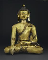 A large and important gilt bronze figure of Buddha Nepal, 14th century, 23 in.  high