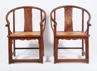 Pair of Chinese Huanghuali and Hardwood Horseshoeback Armchairs, 17th / 18th century