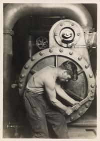 Lot 60: Lewis W.  Hine, Powerhouse Mechanic, silver print, circa 1921.  Estimate $70,000 to $100,000.