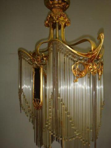 Clarke auction opens winter season with the roberta peters art noveau gilt bronze chandelier with glass and steel rods with amethyst glass plaques aloadofball Image collections