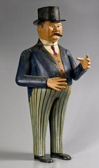 Allan Katz Americana.  Cigar Smoking Man.  American.  Cast and Tooled metal, with its original polychrome painted surface.  Circa 1900.