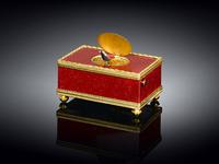 Another example of a singing bird music box (ca.  1900) is this one made in Switzerland from which a chirping songbird emerges from a bright red box once the little key is turned to activate the musical melody.  After singing, the miniature bird moves back inside and the lid automatically closes behind it.