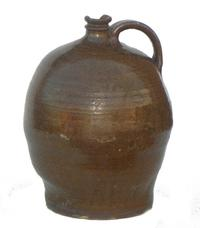 "Two-gallon jug attributed to Dave the Slave and signed ""LM"" for his owner, Lewis Miles (est.  $8,000-$12,000)."
