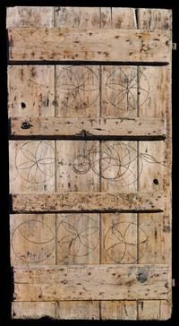 Oak calf-shed door marked with magical symbols to protect livestock.  From Laxfield, Suffolk, 19th century.  183 x 94 cm.