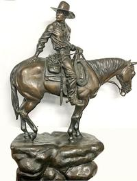 Bronze depiction of a cowboy on horseback by California sculptor Betty Saletta, titled Yesterday is Tomorrow, dated 1990, 31 inches tall ($5,000).