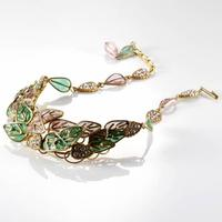 Gorgeous Chanel Gripoix green and pink poured glass plique a jour necklace with layered leaf motif, set in gold tone and diamante details (est.  $800-$1,200).