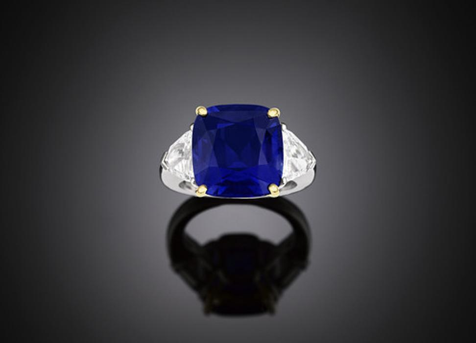 This $2,250,000 intense blue Kashmir sapphire is 14.44 carats, remarkably flawless and a deep blue color.  It is set in platinum along two trapezoid diamonds each 2.08 carats.