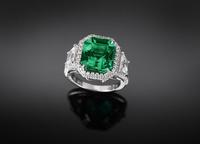 A smoldering natural Colombian emerald weighs 6.38 carats and is a stunning example of a step-cut gem.  The ring is platinum and sells for $388,500.