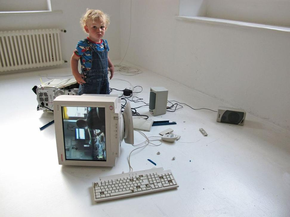 Eva and Franco Mattes, My Generation, 2010.  Video (13 minutes, 18 seconds), broken computer tower, CRT monitor, loudspeakers, keyboard, mouse, and various cables; overall dimensions variable.  Installation view, Plugin, Basel