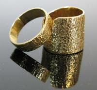 This matched pair of modernist, 14k gold wedding bands by celebrated Greenwich Village designer, Sam Kramer, are estimated to realize $1,000 - $2,000 by E.M.  Wallace as part of the Summer Delights auction, with online bidding offered by Invaluable.