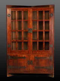 1905 Gustav Stickley oak corner cupboard with original copper strap hardware and finish.