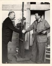 Diego Rivera shaking hands with Timothy Pflueger, 1940.  Courtesy San Francisco History Center, San Francisco Public Library.