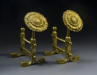 "Hirschl & Adler Galleries sold this Thomas Jeckyll (1827-1881) pair of Sunflower ""Fire-Iron"" Rests, c.  1879 Brass, patinated & incised, 10 1/2"" x 5 "" x 6 1/2"""