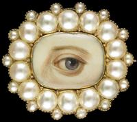 Old oval brooch and pendant surrounded by fourteen split pearls with fourteen small satellite pearls, ca.  1835–40.  inscribed initials on reverse: J.a.t., W.v.t., J.m.t.  Brown left eye.  Purchased from Leah Gordon Antiques, New York.  Dimensions: 11⁄8 × 1 × 1⁄4 in.