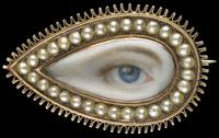 Gold teardrop-shaped brooch surrounded by split pearls, ca.  1790.  Blue right eye.  Dimensions: 3⁄4 × 11⁄4 × 1⁄4 in.