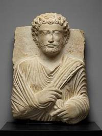 "Funerary bust with inscription, ""Maqî son of M'anî,"" Palmyrene, anonymous maker, ca.  200 CE.  Limestone.  20.5 x 14.6 x 7.1 in.  (52.1 x 36.7 x 17.9 cm).  The J.  Paul Getty Museum at the Getty Villa"
