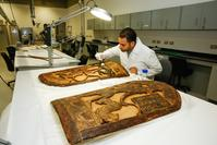 Restorer Ahued El Sheikka carries out a complete restoration of two shields from the tomb of Tutankhamun.
