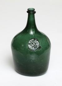 An important green seal bottle for Pyrmont Water, circa 1750.