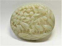 Chinese Qing Dynasty celadon white jade plaque, showing a fine, reticulated carving of a phalanx of storks foraging in a marsh in high relief ($2,812).