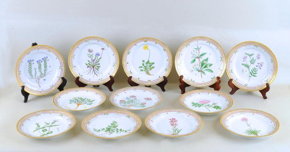 "Lot 182 is a rare set of twelve (12) Royal Copenhagen ""Flora Danica"" plates with various floral hand painted details, 8 5/8"" diameter."