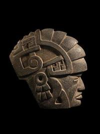 Mayan work is a hard stone Ruler/Shaman with Armadillo, 11 inches high, dating to 600-900 CE.